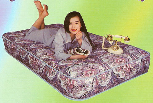 fir bed with lady on it